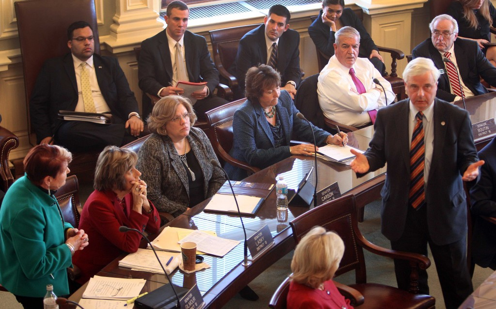 State Sen. Peggy Gilmour, D-Hollis, left, listens as Sen. Jeb. Bradley, R-Wolfeboro, answers her question during a special session the N.H. Legislature on Thursday at the Statehouse in Concord, N.H.