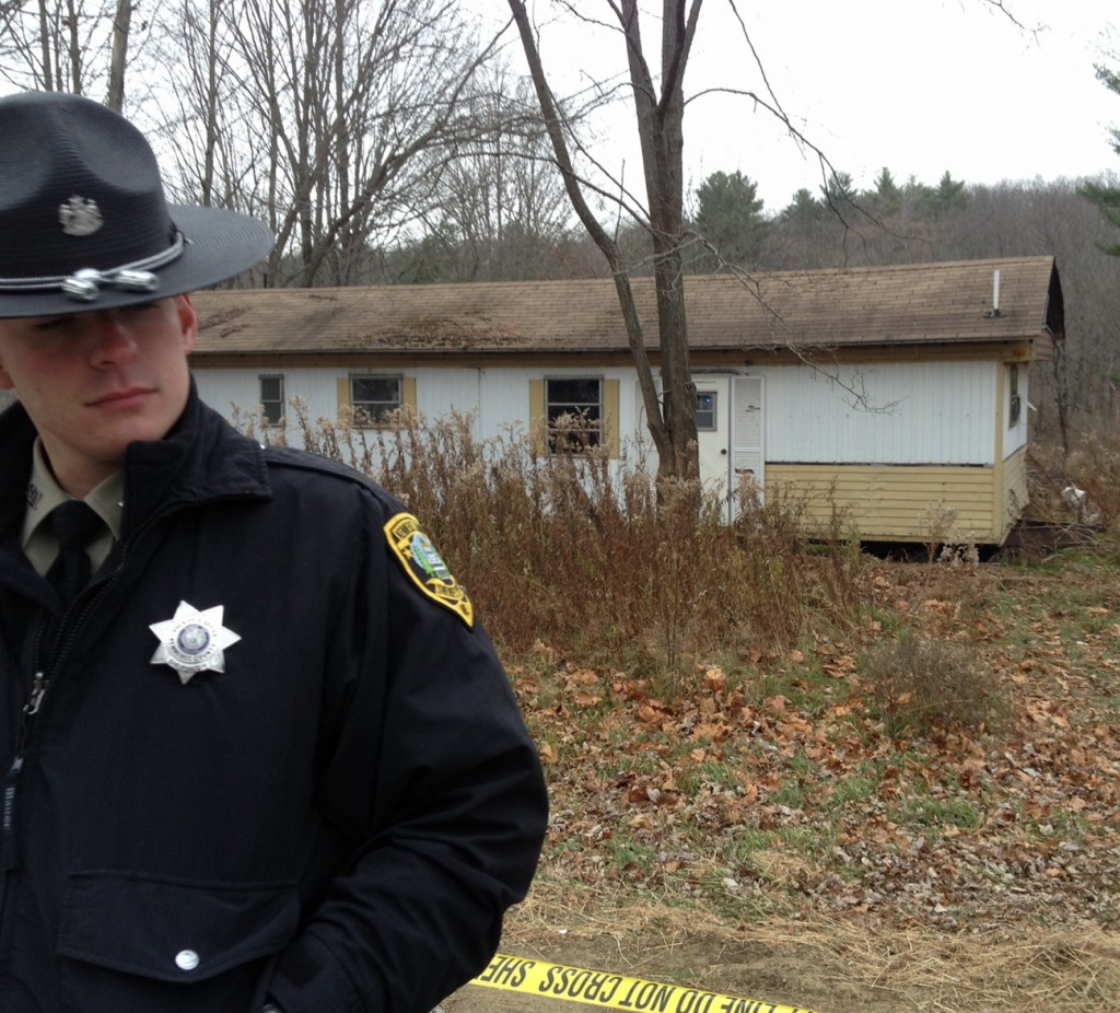 Sheriff's Deputy Aaron Moody guards a mobile home in Vassalboro on Friday after the body of a Waterville man was found outside it. Police do not know if the man died there.