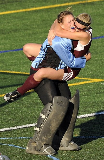 Gabe Souza/Staff Photographer Foxcroft goalie Brianna Skolfield hugs teammate Amber Anderson after the Ponies defeated NYA for the Class C field hockey championship at Yarmouth High School Saturday, November 2, 2013.