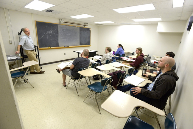 Bob Coakley teaches a physics class at the University of Southern Maine in Portland. With 8,923 students, USM's overall fall enrollment is down 4.9 percent, with a 7.5 percent drop in graduate enrollment and a 4.2 percent drop in undergraduate enrollment.