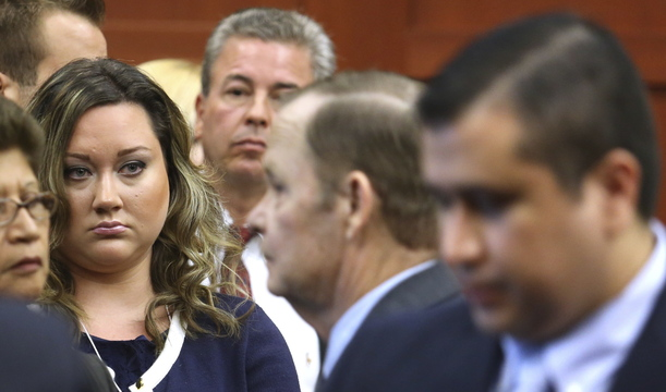 George Zimmerman's wife, Shellie, watches her husband leave the courtroom during his murder trial in July. Since his acquittal, he has had several brushes with law enforcement.