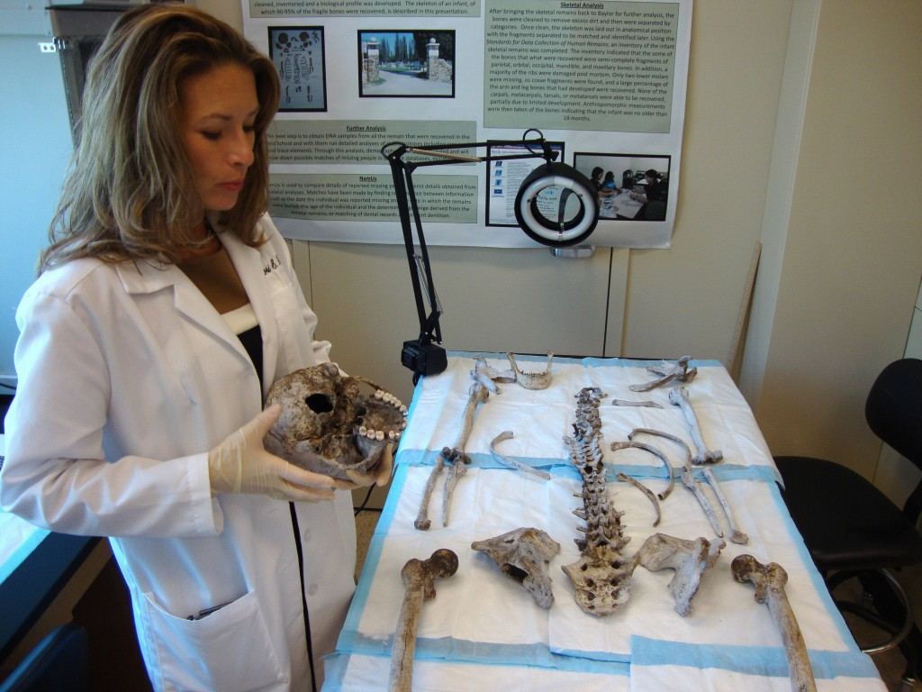 Forensic anthropologist Lori Baker of Baylor University takes inventory of human remains found at a ranch in southern Texas, a region where would-be immigrants from Mexico died in the desert.