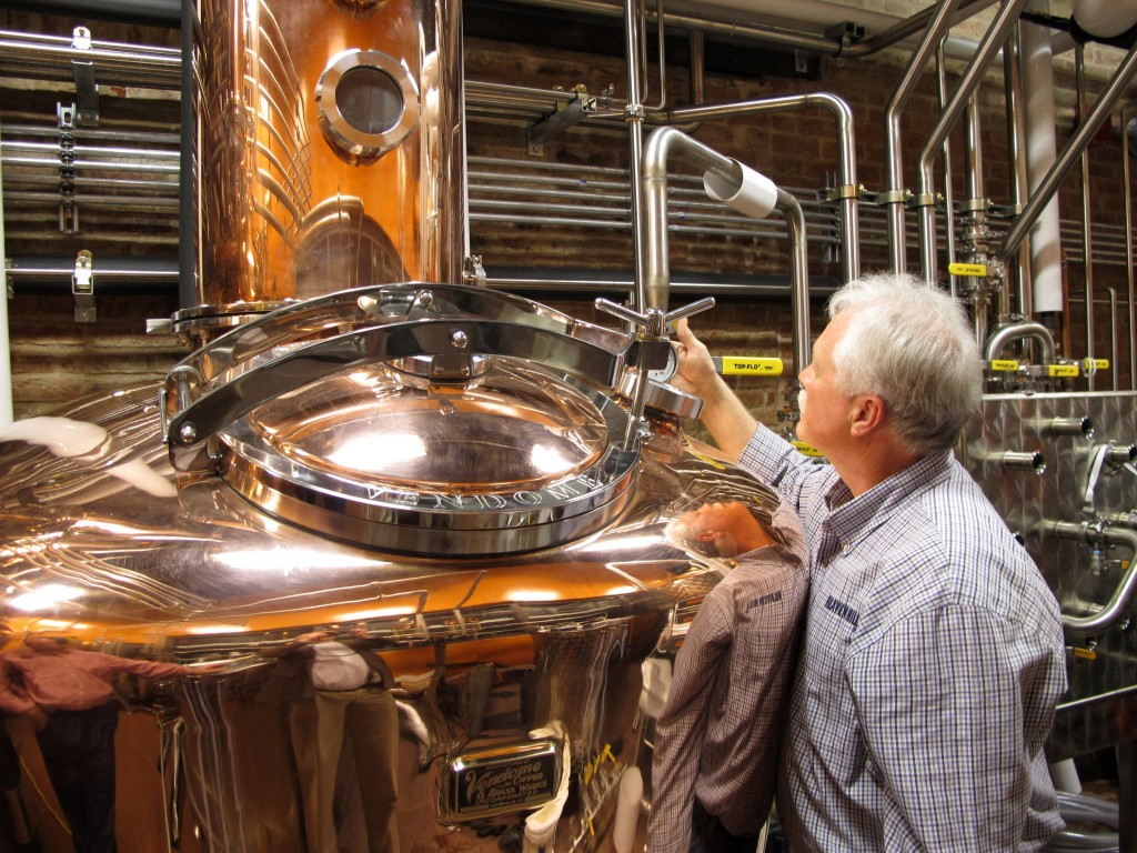 Charlie Downs, the artisanal craft distiller at a new Heaven Hill Distilleries tourism attraction in downtown Louisville, Ky., checks gauges on a still that will produce small batches of whiskey. The $10.5 million center, called the Evan Williams Bourbon Experience, is part of the Kentucky Bourbon Trail.