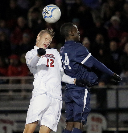Scarborough's Wyatt Omsberg, left, challenges Portland's Jonathan Bobe for possession during the Western Class A final in Scarborough on Wednesday.
