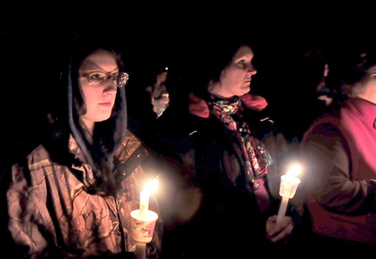 Sherissa McLaughlin, left, of Moscow and her mother Sherry, center, attend a candlelight vigil for Sherissa's friend Jillian Jones in Bingham on Sunday. Jones, who was killed last week in Augusta, grew up in the area.