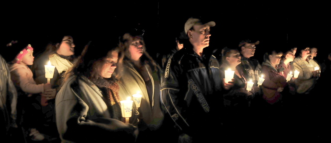 Staff photo by David Leaming TRIBUTE: Close to 150 family and friends attended a candlelight vigil for Jillian Jones in Bingham where she grew up on Sunday, Nov. 17, 2013. Jones was killed last week in Augusta. People remembered Jones, comforted each other and listened to music that she liked.