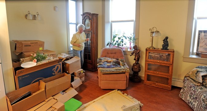Madelaine Baum unpacks in her new fourth-floor apartment in the newly renovated Gerald Hotel in Fairfield.