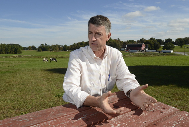 In this Sept. 30 ,2013, photo, Warren Knight talks about being arrested for allegedly blocking Pike Industries from blasting at its quarry next to his Smiling Hill Farm in Westbrook.
