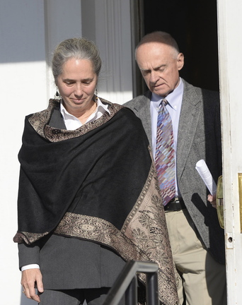 Jan Collins and Irv Faunce leave the York County Courthouse in Alfred on Wednesday after their son Gordon Collins-Faunce was sentenced to 20 years in prison for killing his infant son last year.