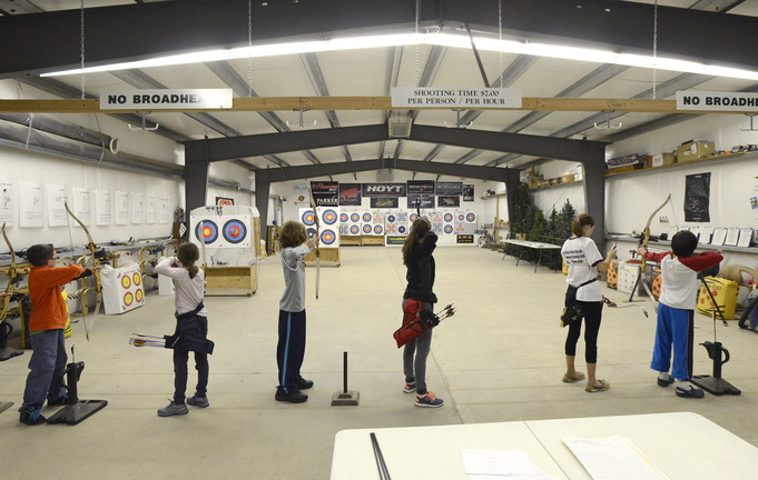 Students take aim during class at Lakeside Archery. The students, ages 10 to 14, are involved in Junior Olympic Archery Development, and some compete in New England tournaments.