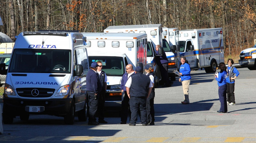 Photo by Jeff Pouland Ambulance crews wait to receive patients outside the Thayer Center for Health in Waterville on Saturday before transporting them to the new Alfond Center for Health in Augusta. The Thayer Center for Health will remain open as an outpatient facility with a 24-hour emergency department.