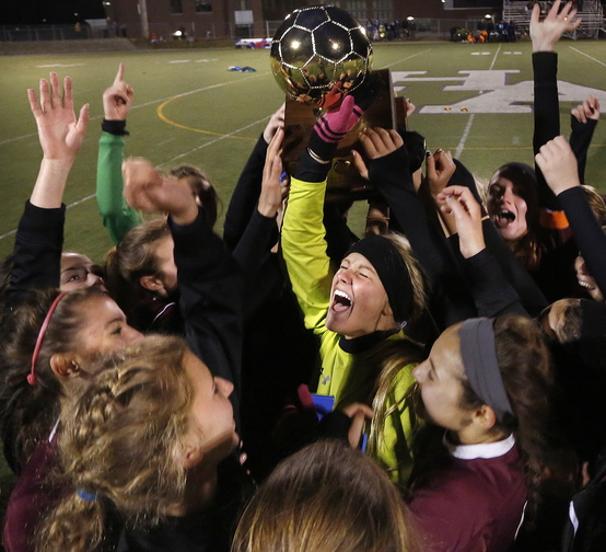 Keeper Mary Perkins, center, leads the celebration after Cape Elizabeth's victory over Waterville in the Class B state championship game at Hampden.