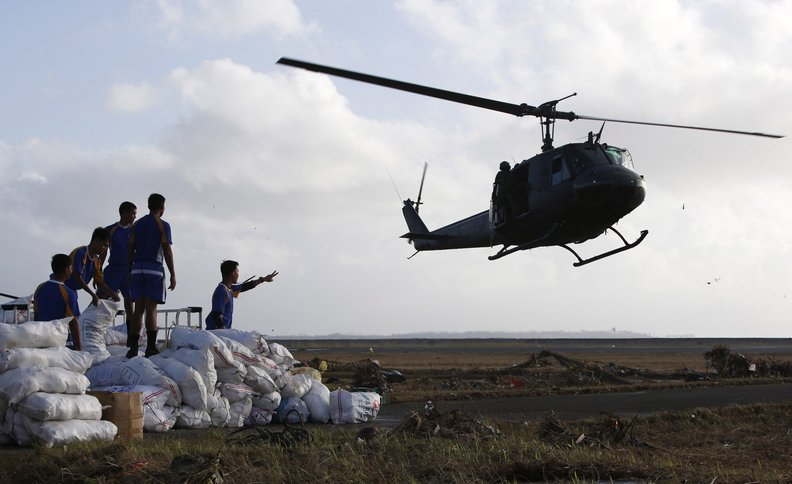 A military helicopter prepares to land to airlift relief supplies for typhoon victims, in Tacloban city, central Philippines.