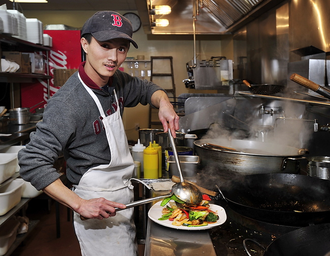 Chef Hai Huang makes Jumbo Shrimp with Mixed Vegetables at Evergreen Chinese Restaurant.