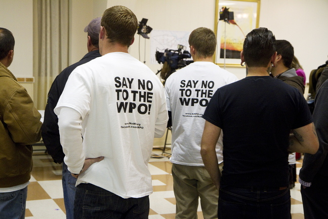 Members of the Working Waterfront Coalition, supporters of Say No to the WPO, gather at the campaign headquarters at the Maine Military Museum in South Portland.