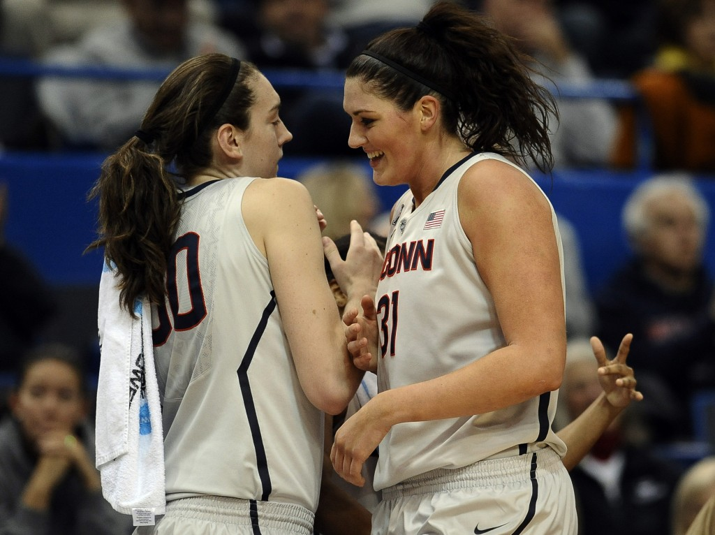 Connecticut's Stefanie Dolson, right, is greeted by teammate Breanna Stewart after finishing a play during the Huskies' rout over Oregon on Wednesday.