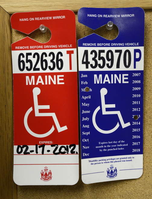 Examples of placards that parking officer Andy Martin looks for as he patrols the Old Port looking for illegal handicapped parking.