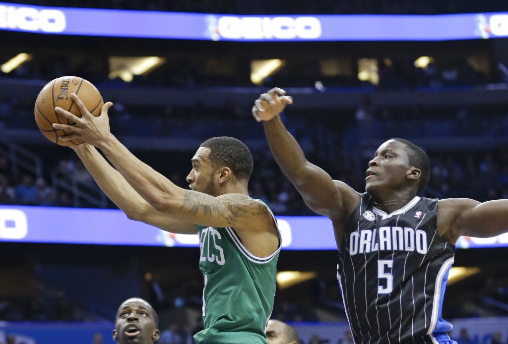 The Boston Celtics' Courtney Lee, left, gets a shot off in front of Orlando Magic's Victor Oladipo during the first half of the NBA basketball game in Orlando, Fla., on Friday.
