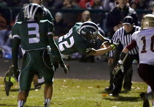 Jon Woods of Bonny Eagle dives into the end zone, a 10-yard run for the first touchdown of the game Friday night. The Scots went on to beat Thornton Academy 28-13 and will meet Cheverus for the Class A state title next Saturday at Fitzpatrick Stadium.
