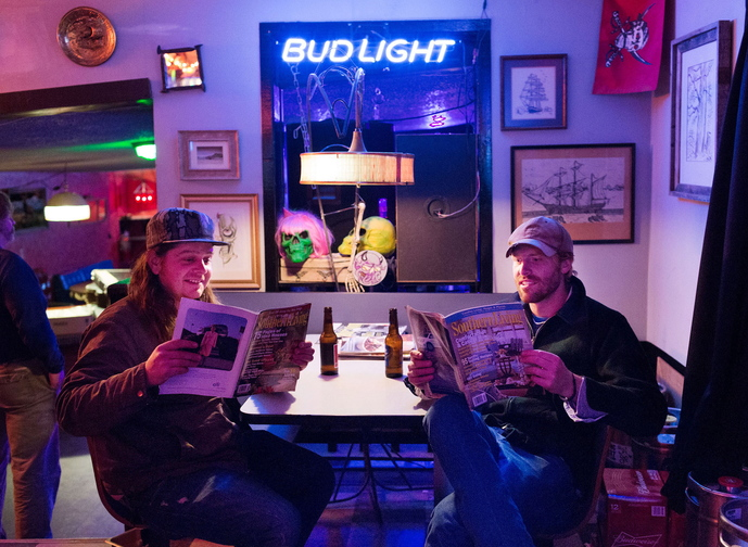 It's almost showtime in Chapel Hill, N.C., and the Mallett Brothers Band's Nick Leen, left, and Will Mallett read Southern Living magazine before going on stage near the end of a grueling six-week tour.