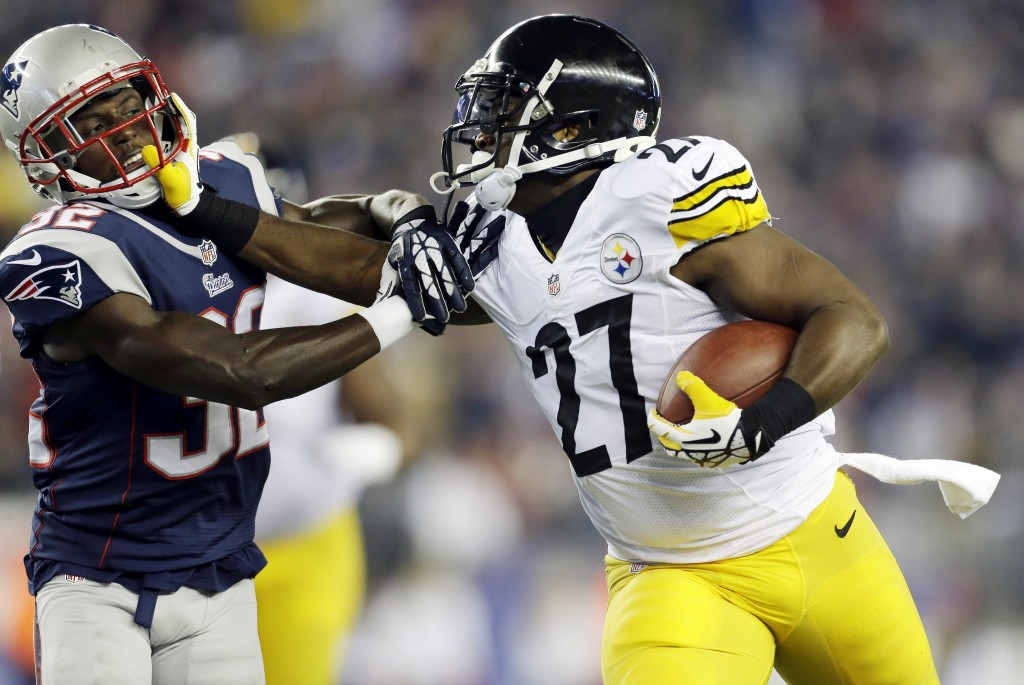 Pittsburgh Steelers running back Jonathan Dwyer (27) stiff-arms New England Patriots free safety Devin McCourty during a run in the second quarter on Sunday, Nov. 3, 2013, in Foxborough, Mass.