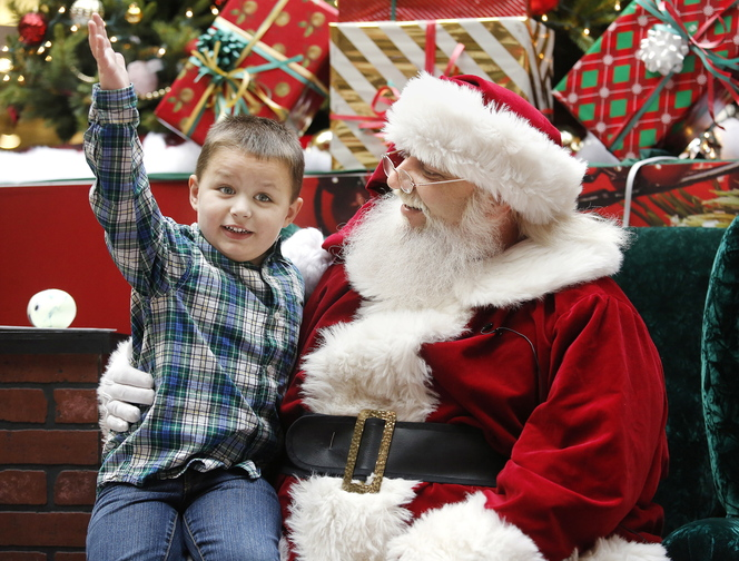 AJ Sweet, 4, of Windham meets Caring Claus on Sunday, during a special time for children with autism at the Maine Mall.