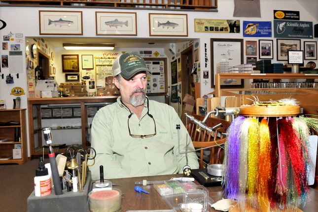 Bob Mallard, owner of Kennebec River Outfitters in Madison, speaks recently about the decline in trout fishing on the nearby Kennebec River and the negative impact on his business.