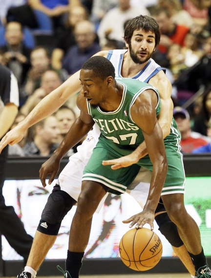 Jordan Crawford of the Boston Celtics attempts to keep the ball away from Ricky Rubio of the Minnesota Timberwolves during Minnesota's 106-88 victory Saturday night.