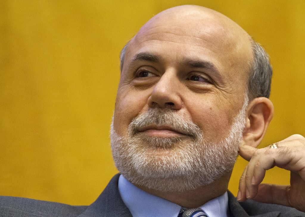 "Federal Reserve Chairman Ben Bernanke participates in a panel discussion at the International Monetary Fund in Washington on Friday. He spoke about new rules to close large insolvent banks without hurting the broader financial system. ""Our continuing challenge is to make financial crises far less likely,"" he said."