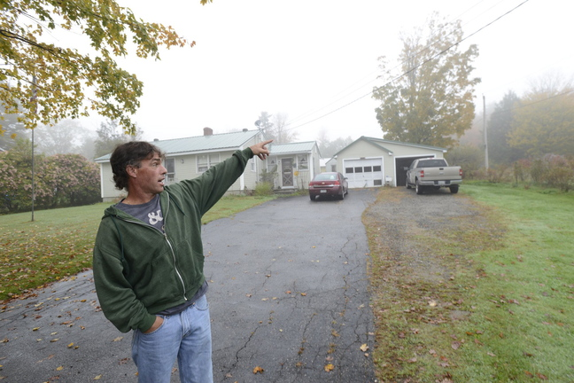 Ron Lafebvre, grandson of the property owner, points to where a fatal shooting took place at Brown's Bee Farm in North Yarmouth.