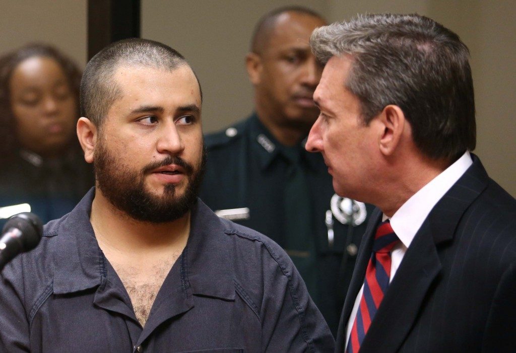 George Zimmerman, acquitted in the high-profile killing of unarmed black teenager Trayvon Martin, faces his defense counsel Jeff Dowdy in court Tuesday, Nov. 19, 2013, in Sanford, Fla., during his hearing on charges including aggravated assault stemming from a fight with his girlfriend.