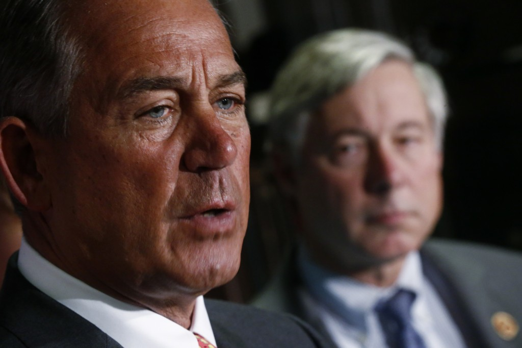 House Speaker John Boehner of Ohio, accompanied by Rep. Fred Upton, R-Mich., speaks aafter Republican lawmakers met at the Republican National Committee headquarters in Washington, Wednesday, Nov. 13, 2013.