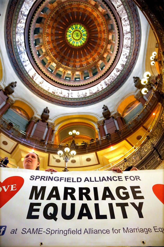 Supporters of same-sex marriage legislation rally in the rotunda at the Illinois State Capitol during a session Tuesday in Springfield Ill.