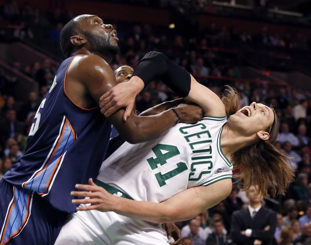 Al Jefferson, who had 22 points and 11 rebounds for the Charlotte Bobcats – fights for rebound position Wednesday night with rookie Kelly Olynyk of the Boston Celtics in the first period of Charlotte's 89-83 victory that ended Boston's four-game winning streak.