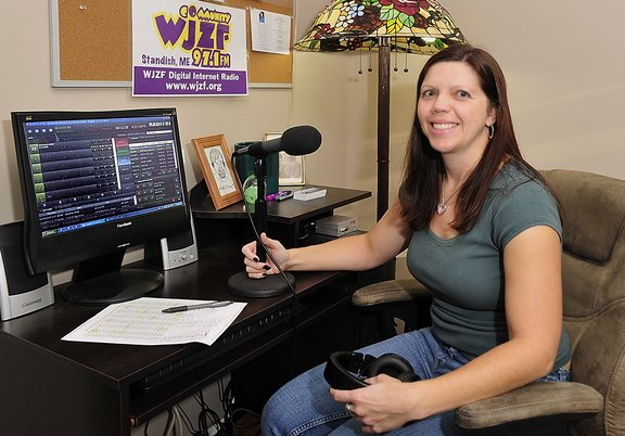 Kristie Doyle runs a community radio station out of her house in Raymond in memory of her late uncle, who produced shows from the chair in which she's sitting.