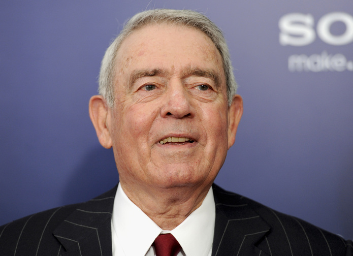 "This Oct. 5, 2011 file photo shows journalist Dan Rather at the premiere of ""The Ides of March"" in New York. The 50th anniversary coverage of the Kennedy assassination on CBS News won't include the recollections of the longtime anchor, further proof of the lingering bitterness following Rather's messy exit and subsequent lawsuit against the network."