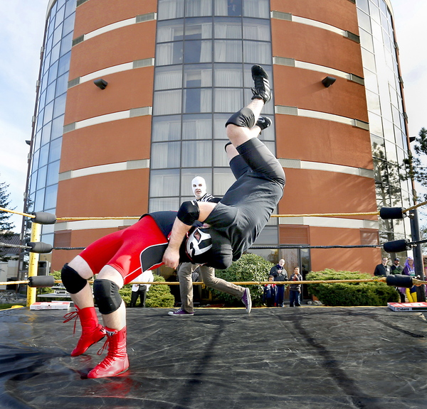 "Jacob ""Magnus Buho"" Cote and Antoine ""Diablo Blanco"" Malaab, both of Portland, wrestle in a match Saturday at Coast City Comicon. The convention also features artists, crafts people, music, dancing and horror films. It continues from 11 a.m. to 6 p.m. Sunday. Admission is $25."