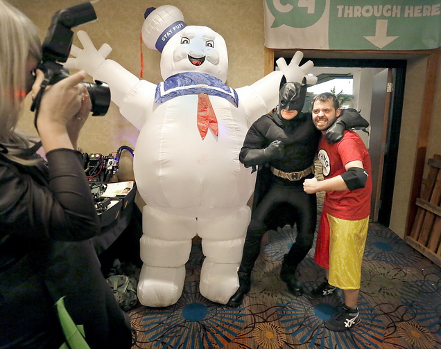Alex Lear of North Yarmouth, dressed as Batman, poses for a picture with Nate Speckman of Portland next to the Stay Puft Marshmallow Man during the Coast City Comicon convention at the Double Tree Hilton in South Portland on Saturday afternoon.