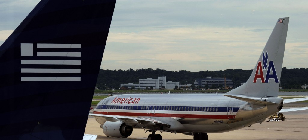 The federal government has a Nov. 25 trial date for a lawsuit aimed at preventing a merger between American Airlines and US Airways.