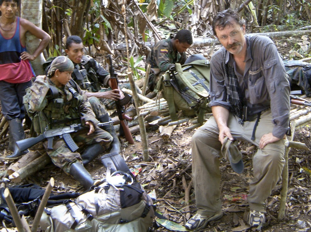 Robert Young Pelton, shown in Borneo in a 1996 photo, has drawn a mixed response for his fundraising scheme to pursue Joseph Kony, the mastermind of the Lord's Resistance Army. The militia group is suspected of committing atrocities across three African nations.