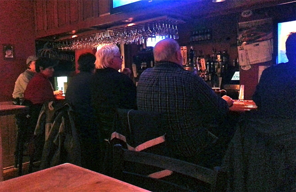The cozy bar room has plenty of TVs for watching a game.