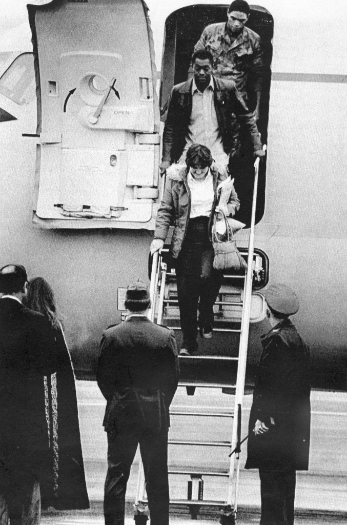 In this July 20, 1979, photo, the first three hostages released from the U.S. Embassy in Tehran, arrive at Rhein-Main U.S. Air Force base in Germany. From the top of the steps are Marine Sgt. William Quarles, Marine Cpl. Ladell Maples and Kathy Gross.