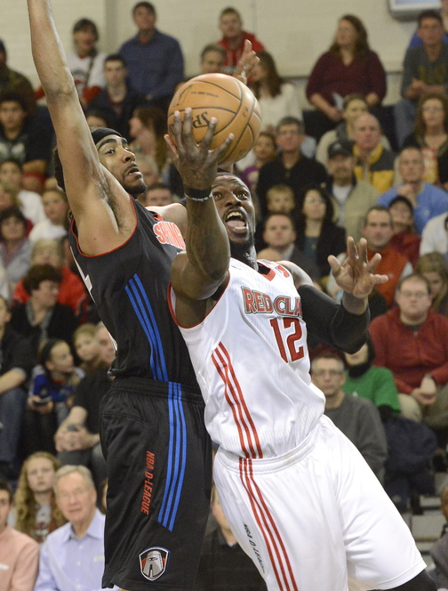 Maine's Jermaine Taylor leans in for a shot against Springfield's JamesOn Curry as the Red Claws hosted the Springfield Armor in the season opener at the Portland Expo on Friday.