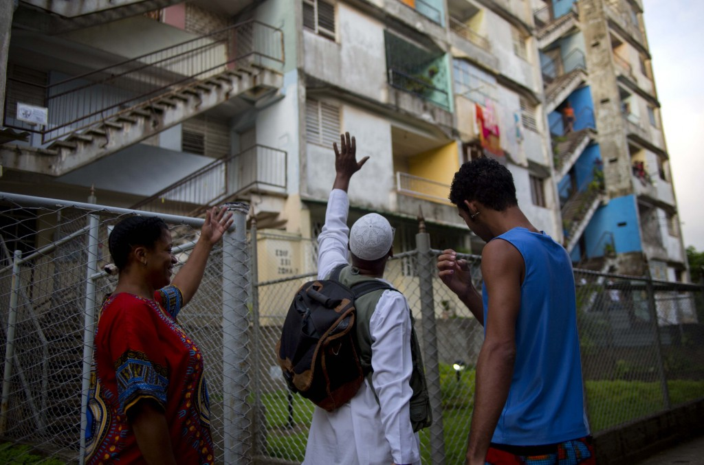 William Potts waves goodbye to neighbors in Havana, Cuba, Wednesday, before heading back to the U.S. and an uncertain legal future. FBI agents took the 56-year-old Potts into custody Wednesday shortly after his charter flight from Havana arrived at Miami International Airport.