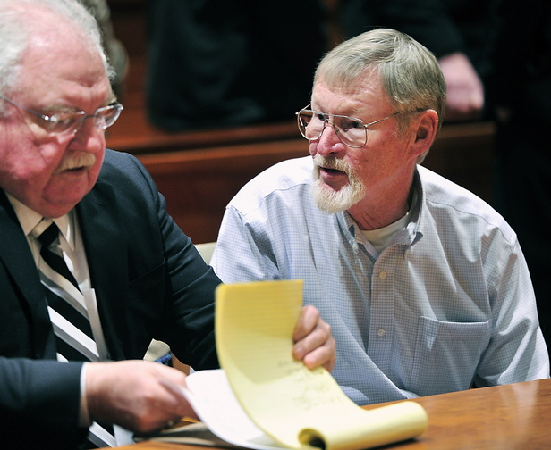 Merrill Kimball talks with his attorney, Daniel Lilley, left, after pleading not gulty Thursday in Cumberland County Unified Criminal Court.