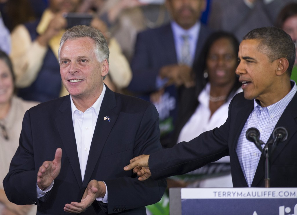 President Obama points to Virginia Democratic gubernatorial candidate Terry McAuliffe as they appear at a McAuliffe campaign rally at Washington Lee High School in Arlington, Va., Sunday. Democrats hope Obama's public backing of McAuliffe will excite the base in Virginia.