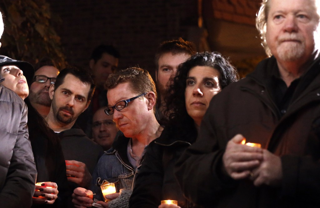 Friends and former employees of Chicago chef Charlie Trotter gather outside his former restaurant for a candlelight tribute Tuesday.