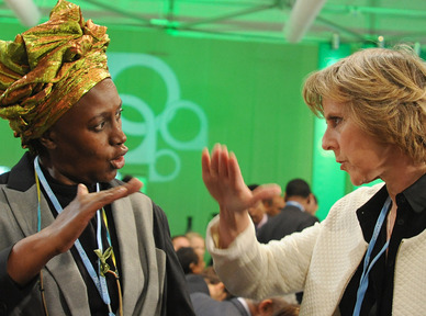 "Alice Akinyi Kaudia of Kenya, left, talks with European Climate Commissioner Connie Hedegaard at the U.N. climate change conference in Warsaw, Poland, last week. Hedegaard said Sunday that the international conference ought to provide a ""substantial answer"" to global warming by 2015."