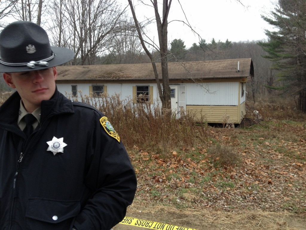 Kennebec County Sheriff's Deputy Aaron Moody guards the property at 2349 Riverside Drive in Vassalboro on Friday morning after a man was found dead there.