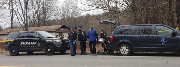 Officials prepare to remove the body of a man found Friday morning in Vassalboro.